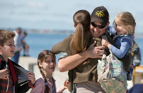 Lieutenant Calvin Timms greeted by his wife and children as HMAS Waller returns to her home port.